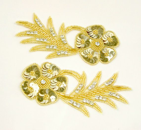 Stunning pair of flower/leaf frond appliques, featuring gold sequins and glass beadwork, with sparkling rhinestone accents.  Fabulous for Gatsby head pieces, sashes, hair combs, DIY projects, wedding/bridal accessories, etc..  Also available in silver.