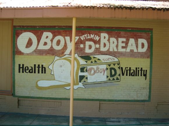 Original old sign on side of building in Webster, Florida across the road from the Webster Flea Markets.