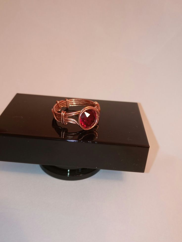 Cooper ring and red stone