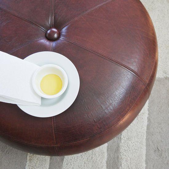 Homemade Leather Furniture Cleaner  Paper towels  1/4 cup vinegar  1/4 cup olive oil  10 drops lemon or orange essential oil (optional)