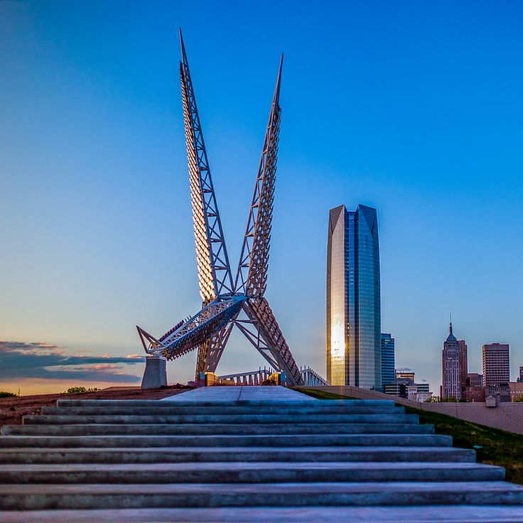SkyDance Bridge in Oklahoma City. A foot bridge inspired by the scissor-tailed flycatcher, Oklahoma's state bird. In the background is OKC's skyline featuring the newly completed Devon Energy Tower.