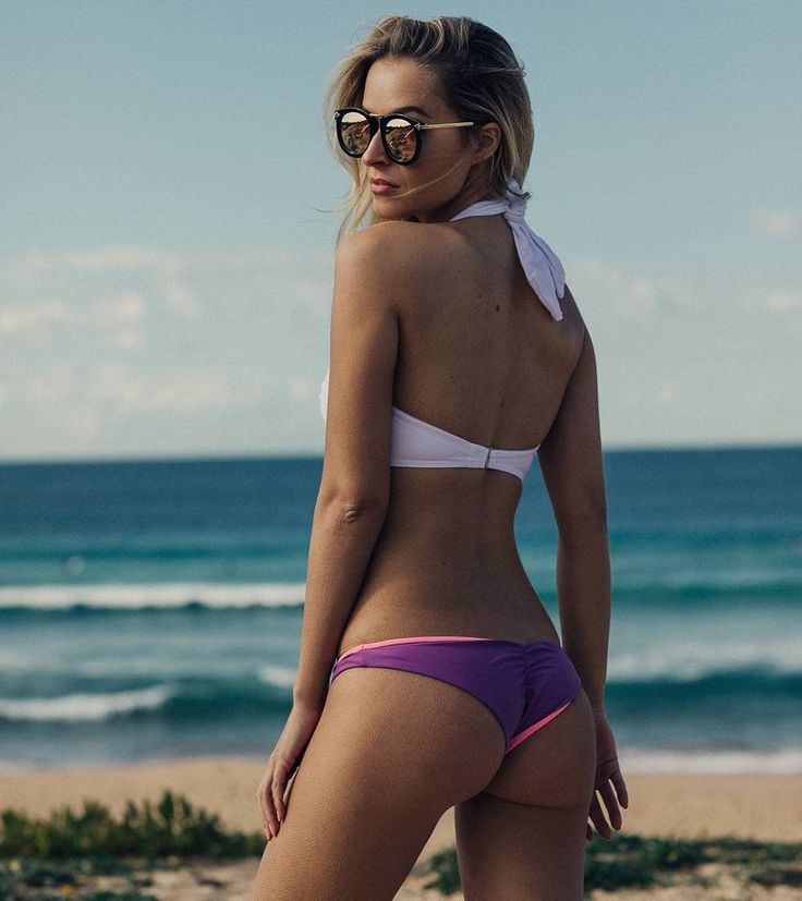 https://www.dollboxx.com.au On Sundays we sun-daazzee  #dollboxx Goddess @georgiagravanis looking amazing in our White Multiway Bandeau Bikini Top and reversible pink and purple Flaunt It Bottoms