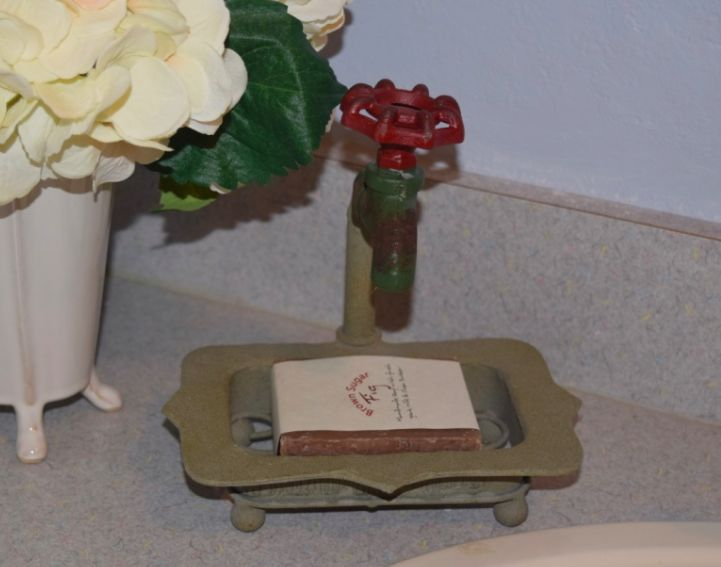 "Tuscan Soap Dish This soap dish reminds us of an Italian movie where the lady buys the old house and everything falls apart. I love that movie just as much as I love this faucet soap dish.  7"" tall Iron Soap Holder with Faucet"