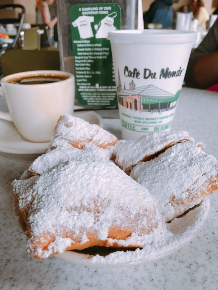Cafe DuMonde Beignets and Chicory coffee are a MUST - Eat Your Way Around New Orleans and taste how diverse the city's culinary scene is. If you are traveling to NOLA check out these restaurants we visited on a recent trip and are sure to go back to again and again