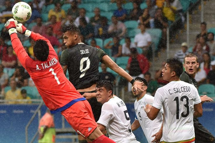 High jump:    Davie Selke, second from left, of Germany vies for the ball with goalkeeper Alfredo Talavera, left, of Mexico, during the Group C match in Salvador, Brazil, on Aug. 4, 2016.