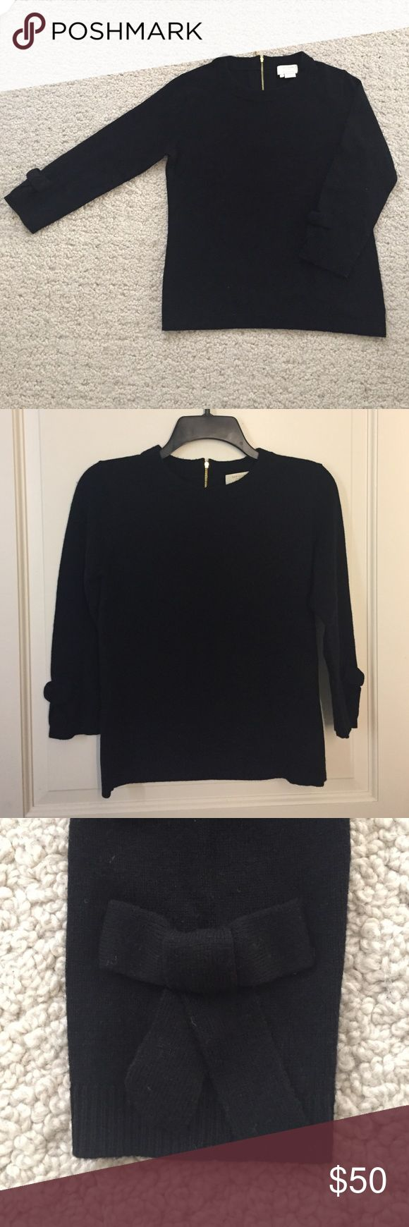 Kate Spade Black Wool/Cashmere Crewneck Sweater, S This black Crewneck Kate Spade Sweater is a size small. 90% wool, 10% cashmere. Three quarter sleeves with ribbon details. Gold zipper in the back hits mid-back. Sweater hits at the top of the hip. Size small. Dry clean only kate spade Sweaters Crew & Scoop Necks