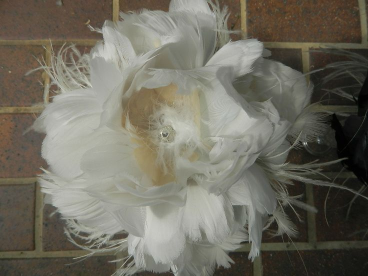 Feather tulip bouquets with a touch of diamante.#featherbouquets, #weddingbouquets, #weddingflowers, #weddingideas