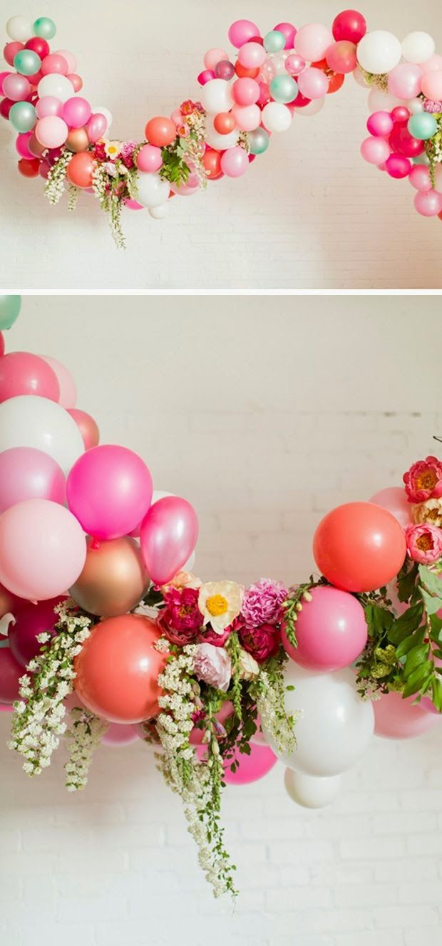 Take balloon arches from 80s-prom to boho-chic with dripping flowers!!