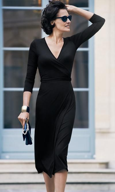 Minimalist black | Ines de la Fressange in a Jersey Wrap Dress.