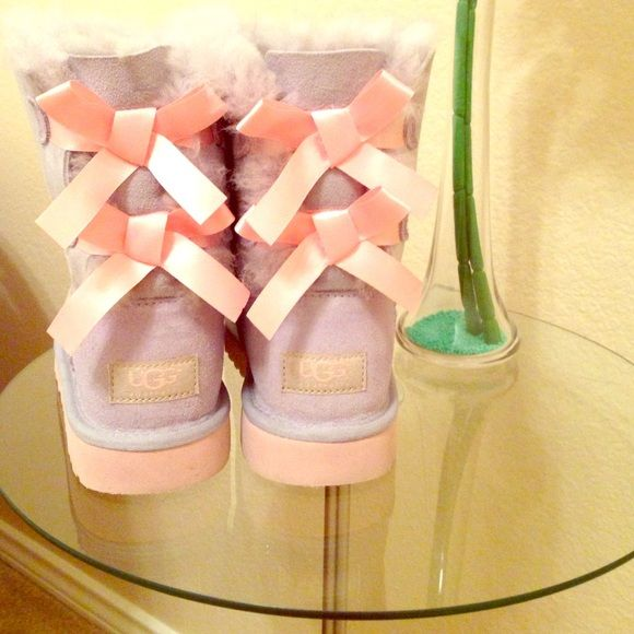 Ugg boots: Bailey bows Lavender with peach bows and bottoms. In good condition. They are  short Bailey bow uggs. UGG Shoes