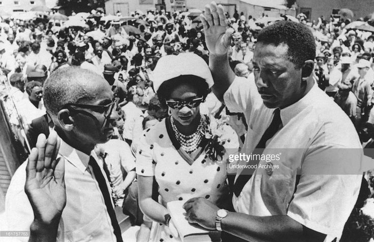 Civil rights leader Charles Evers is sworn in as mayor of Fayette by Justice of Peace Willie Thompson, Fayette, Mississippi, July 7, 1969. Mrs Evers holds the Bible for her husband. Charles is the brother of slain rights activist Medgar Evers..