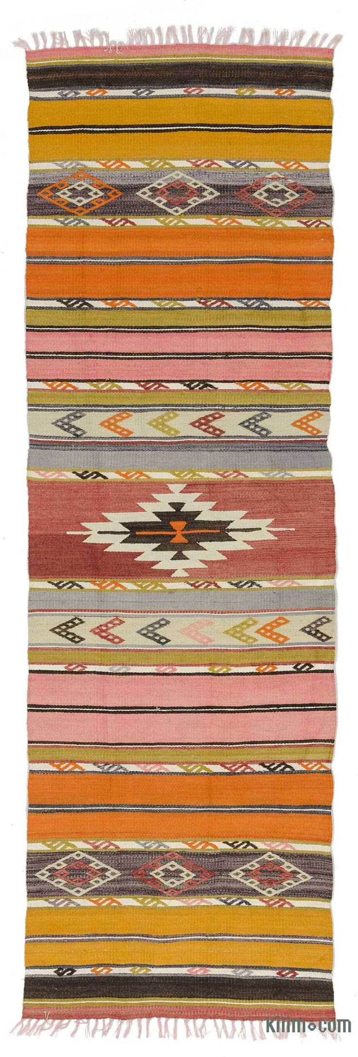 Vintage kilim runner rug hand-woven in the Aegean Region of Turkey in 1970's. This lovely tribal kilim is in very good condition. Rug pad recommended.