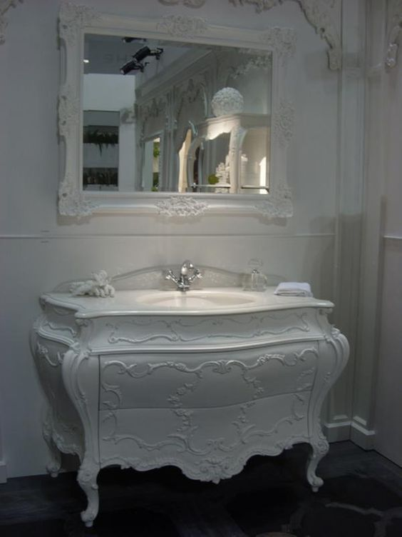 Bombay chest painted a glossy white makes a fabulous vanity. houseindesign.com