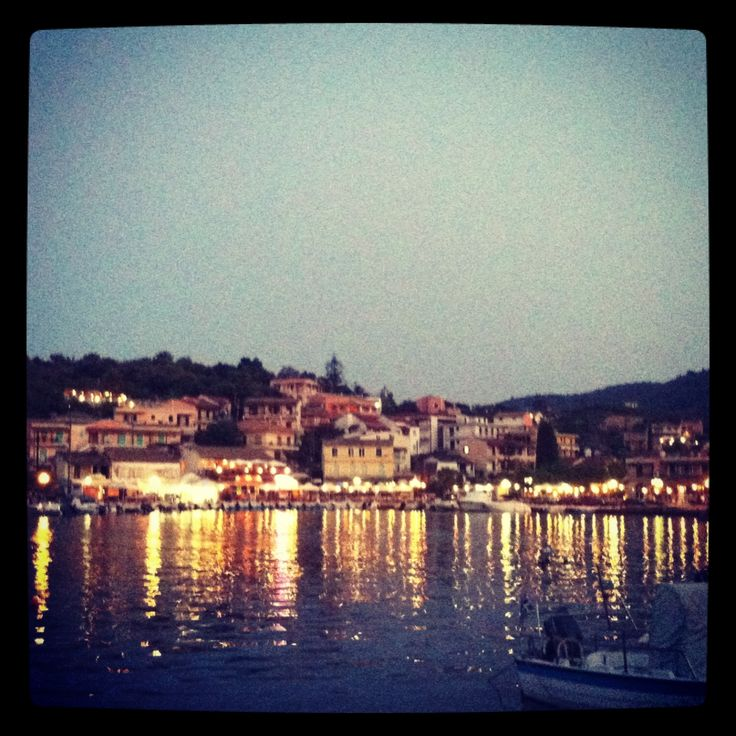 The cute harbour village of Kassiopi after sunset...    *This photo is from our Instagram account. Follow us at TribeTheMag