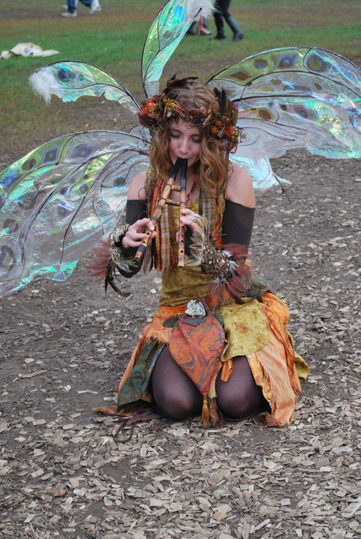 Renaissance Pixie - Loving the cellophane wings and feather wristlets - impressive