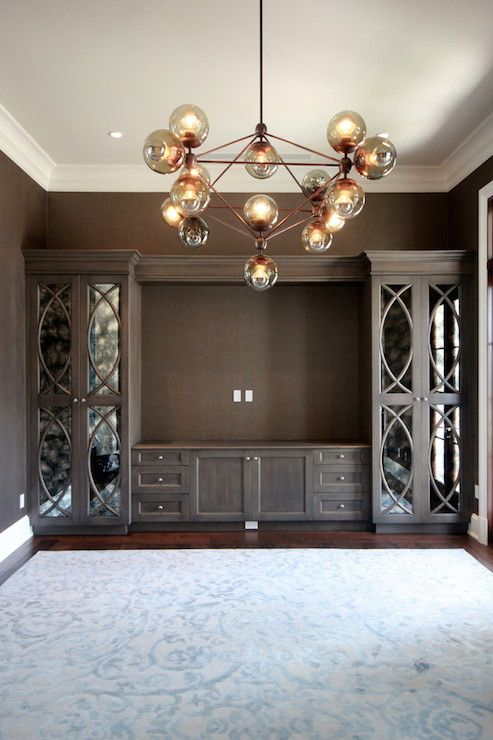 Fantastic Family Room With Built In Media Wall Featuring Dark Brown Central  Cabinets Flanked By Tall Cabinets With Antiqued Mirrored Eclipse Mullion  Doors ...