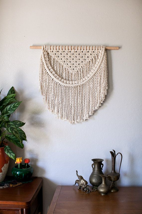 Natural cotton rope compliments any homes style and adds a natural, soft touch to your space. Made to order... Please give me about 1 week to knot this up for you. 6mm 100% Cotton Rope and unfinished 2 wooden dowel. Dimensions: 21 long from where it hangs to the very bottom of the fringe. 24 unfinished wooden dowel