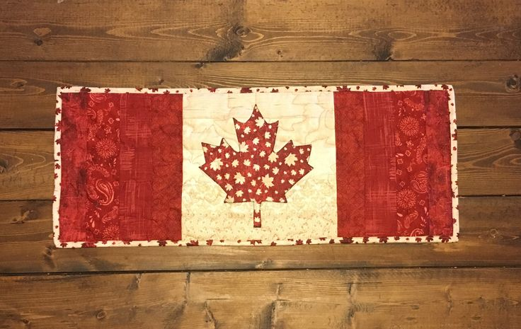 Quilted Legacy- Binding the Generations. Custom quilting and services. Canada Pride table runner.