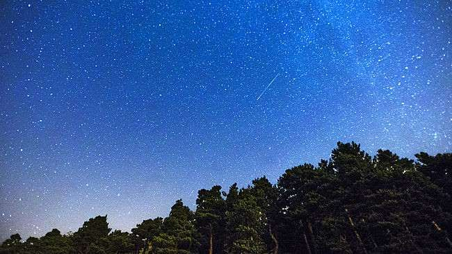 Starry Sky and shooting stars - the annual summer Perseid meteor shower in August will have its peak period this week on the nights of Aug. 11-12, in one of the two best annual meteor showers.