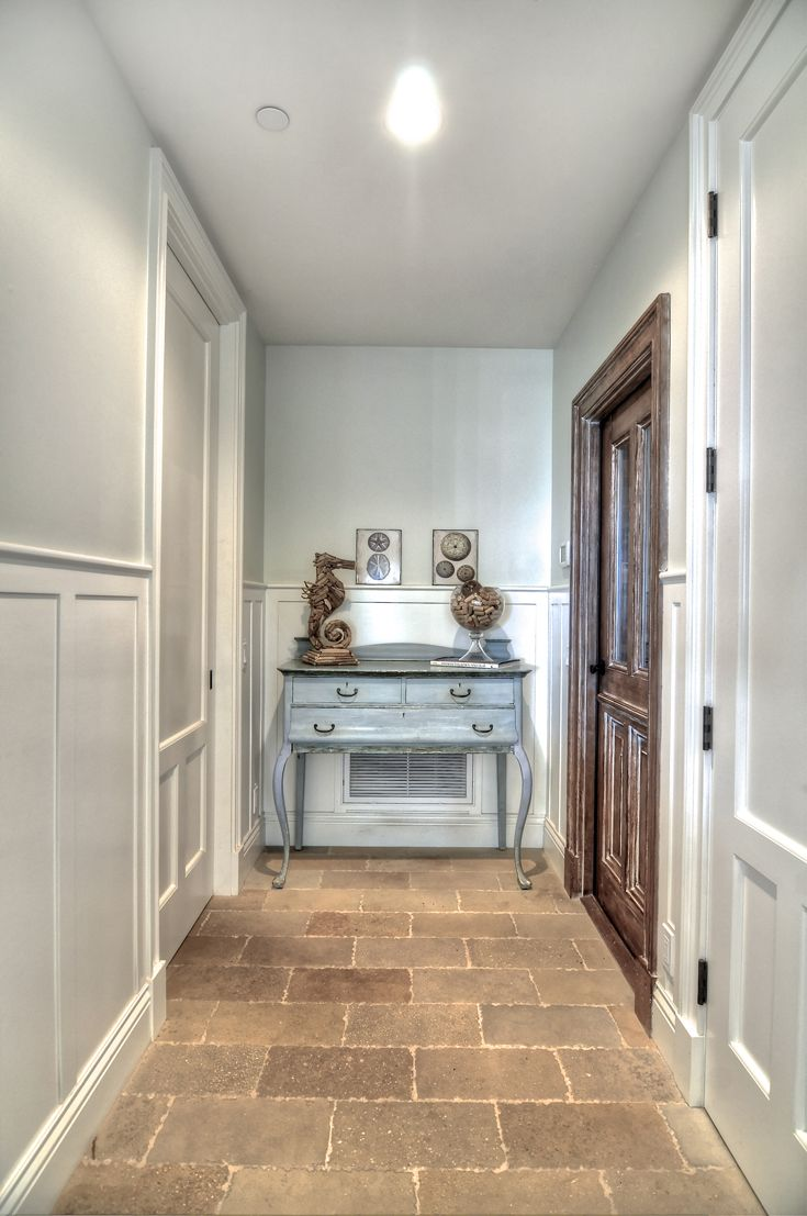 Hallway: New England Architecture, New England style, Colonial, Cape Cod, traditional, classic, beach architecture, beach style, beach organic, natural stone flooring, recessed can light, classic wood wainscot, traditional style door & window trim/molding, painted doors, stained doors with glass.