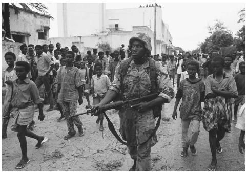 Children follow a United States soldier patrolling the Green Line, a heavily contested area in the Somali civil war of the 1980s, during Operation Restore Hope in 1992.