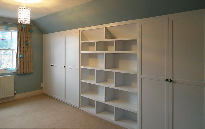 Under eaves wardrobe and bookshelf built in bookshelves for Eaves bedroom ideas
