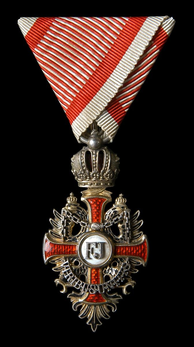 Franz Joseph Order, Knight's Cross badge, mounted on military ribbon. 01