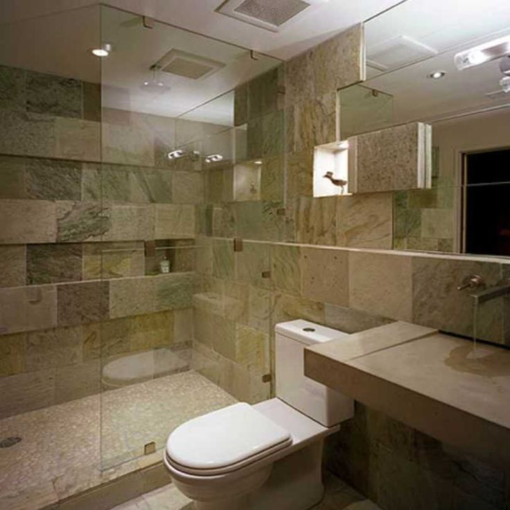 This is a second bathroom that we completely gutted and redone for a local radio personality here in Chicago. The tile is Tumbled Marble that was imported from Italy that took 3 months to be shipped. The Floors are heated.