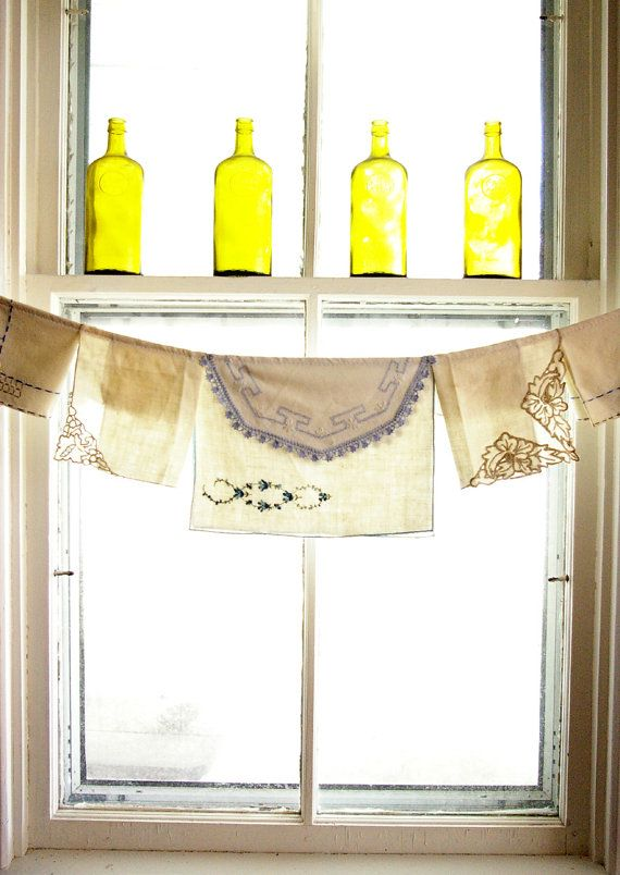 good idea for kitchen windows ... now I just need a crazy collection of vintage linens!