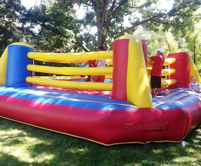 Giant Bouncy Boxing Ring Inflatable. Perfect for college events, birthday parties, family celebrations, corporate events, picnics, carnivals, and much more. Chicago Party Rentals.