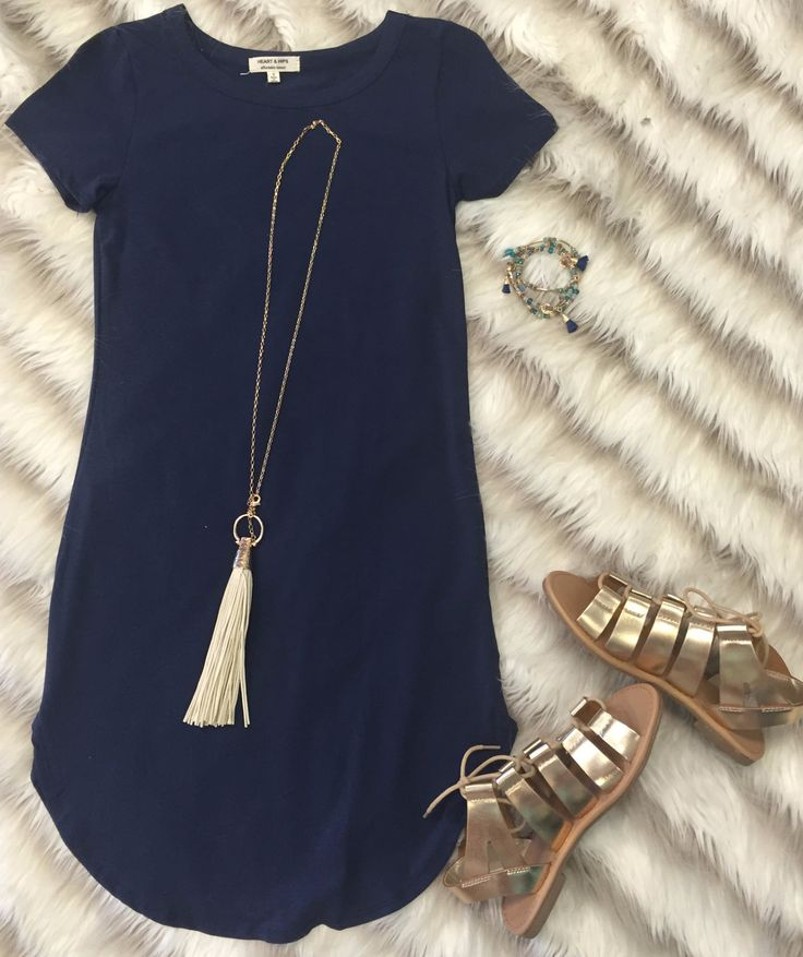 The Fun in the Sun Tunic Dress in Navy is comfy, fitted, and oh so fabulous! A…