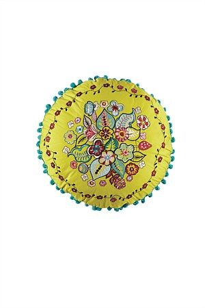 Anna cushion from Kas featured in yellow with contrast pompom trim.