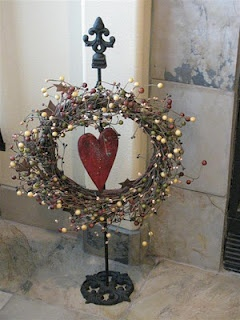 Wreath on a wreath holder.. but do.. a grapevine wreath @Stephanie Ball Warmoth