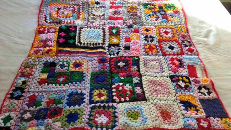 Quirky patchwork style crochet throw.OOAK  multicoloured throw made of hundreds of individual granny squares. Measures 41x38 inch (104x96cm) by Nobodyknitsitbetter on Etsy
