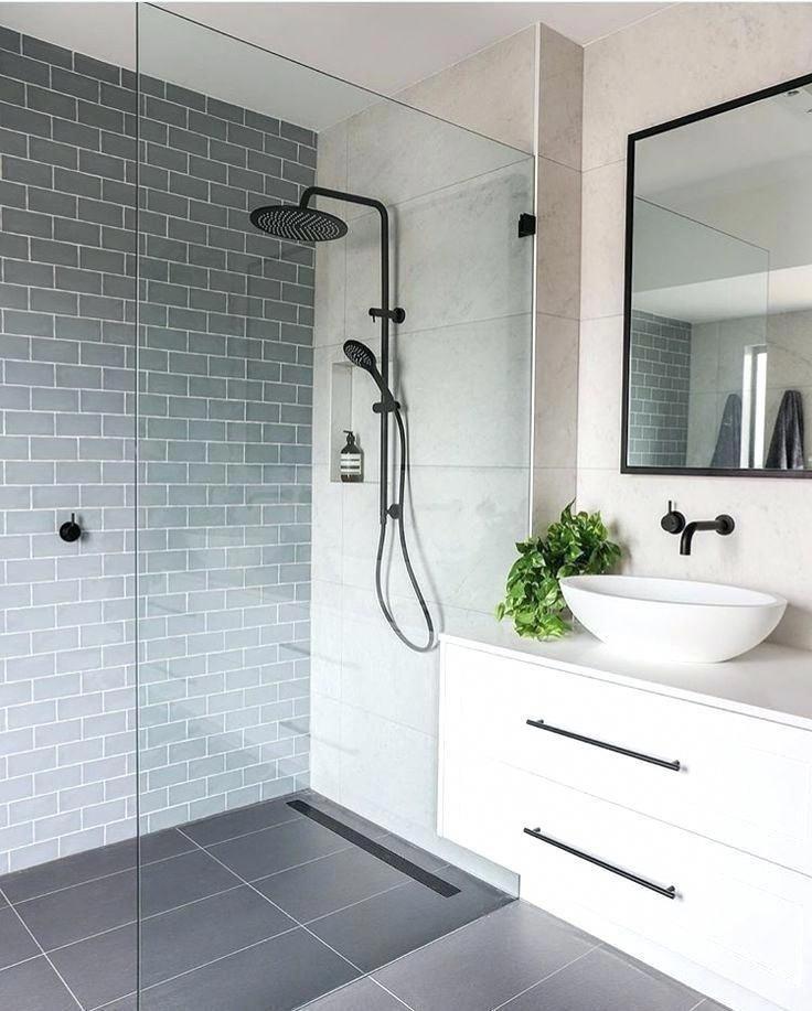Simple Modern Bathroom With White Floating Vanity Blue Gray Subway Tile And Large Format Floor Pale Glass Modern Bathroom Bathroom Floor Tiles Floating Vanity