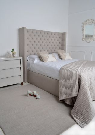 We are delighted to present our gorgeous new Laurent Bed with matching base. Hand made in Britain, available in various linens and velvets and delivered to you all within a 4-6 week turnaround! WOW! With sumptuous deep buttoning and its graceful embracing shape this bed is certainly one of our new favourites. The deep buttoning continues around the inside edges and is finished in the same upholstery on the rear.