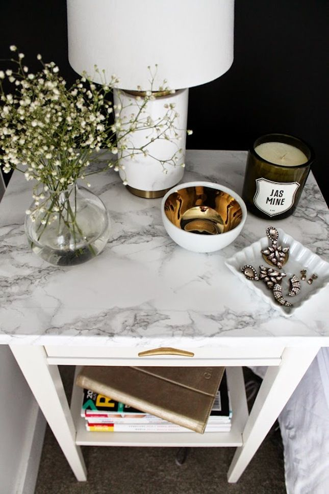 This IKEA nightstand used a marble self-adhesive paper to get that real marble look for a fraction of the price of a real marble nightstand.