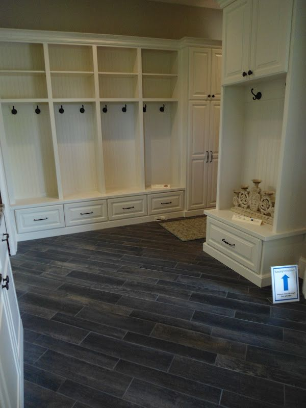 love the diagonal set and color of this distressed wood look porcelain tile