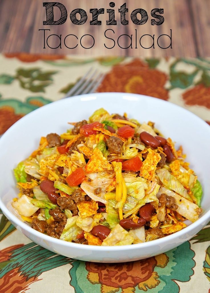 Doritos Taco Salad - taco meat, kidney beans, tomatoes, lettuce, Catalina dressing, cheese and Doritos. Quick Mexican recipe.