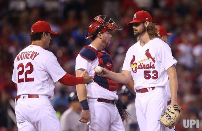 St. Louis Cardinals starting pitcher John Gant hands the baseball off to manager Mike Matheny as he is removed from the game in the sixth…