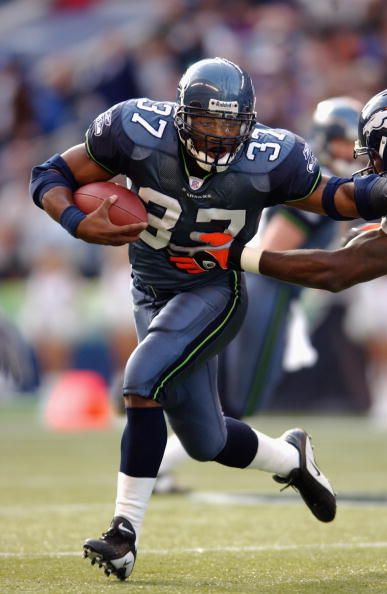 Running Back Shaun Alexander of the Seattle Seahawks rushes the ball during the NFL game against the Denver Broncos at Seahawks Stadium on November...