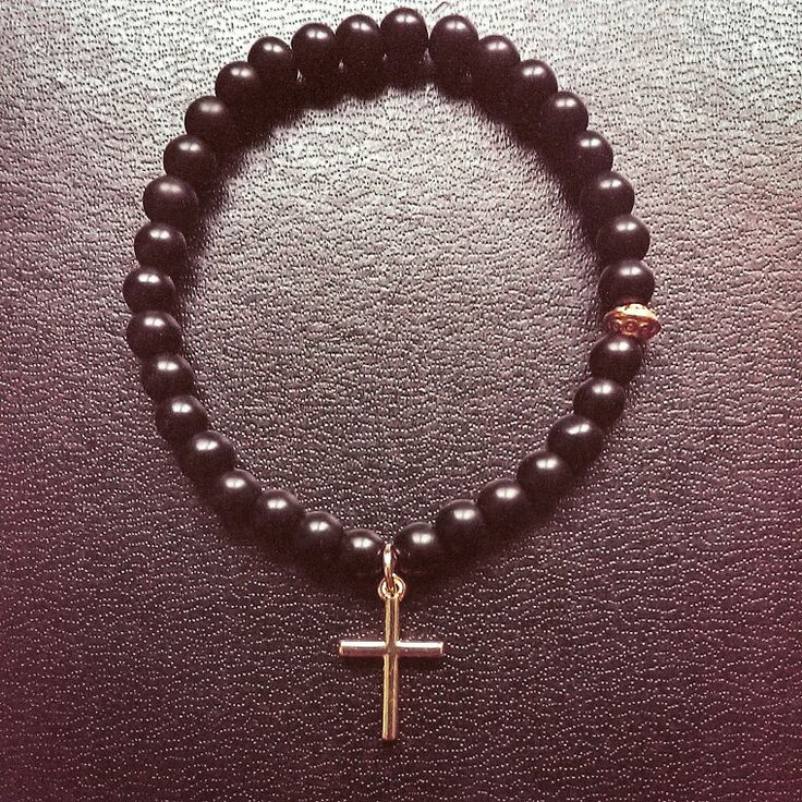Matte black onyx bead with gold cross - $12