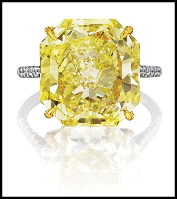 10 carat yellow diamond ring with pavé-set white diamond accents. Center stone is 10.16 carats of GIA-certified Fancy Intense Yellow, VVS1 clarity. Via Diamonds in the Library.