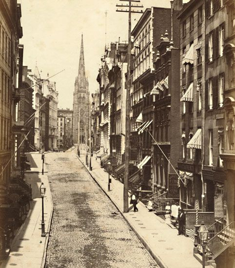 1857 Wall Street, Looking towards Trinity Church, New York City. I know this area of the City as I was in and around it for 30 years. The difference in this photo from my time has me awed.