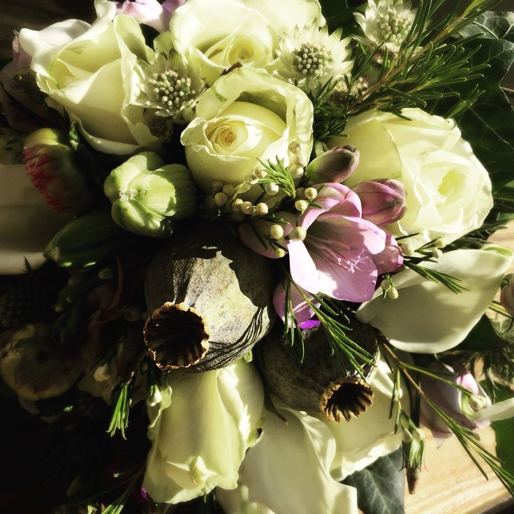 Close up on the asymmetric bride bouquet, a mix of purple and white flowers- beautiful. A good day's work