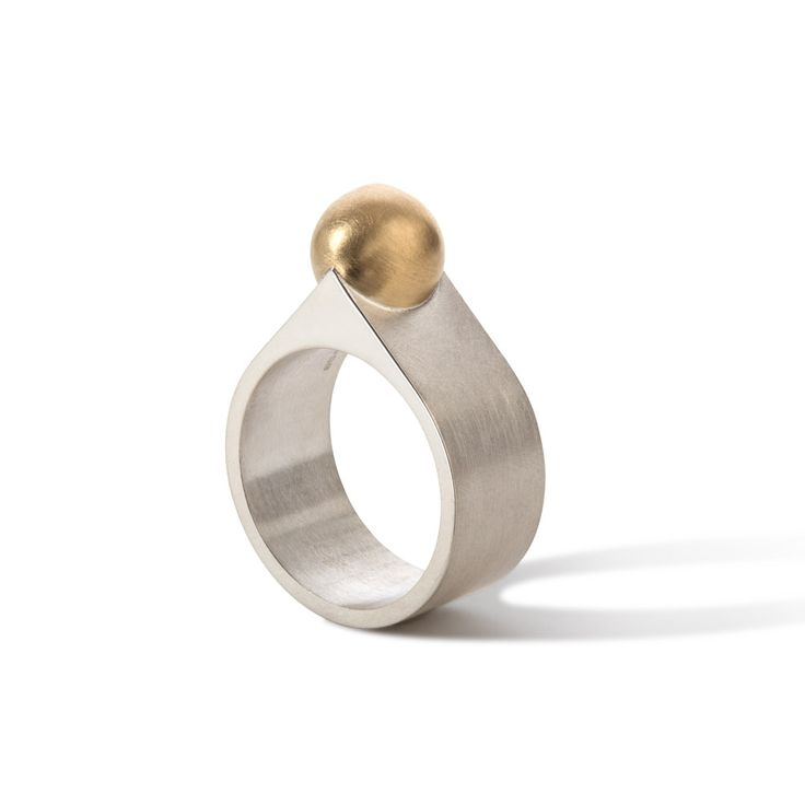 Chunky silver ring of 10mm wide set with an 18ct yellow gold ball. Third out of the series 'Square and Round ring', ltd edition.