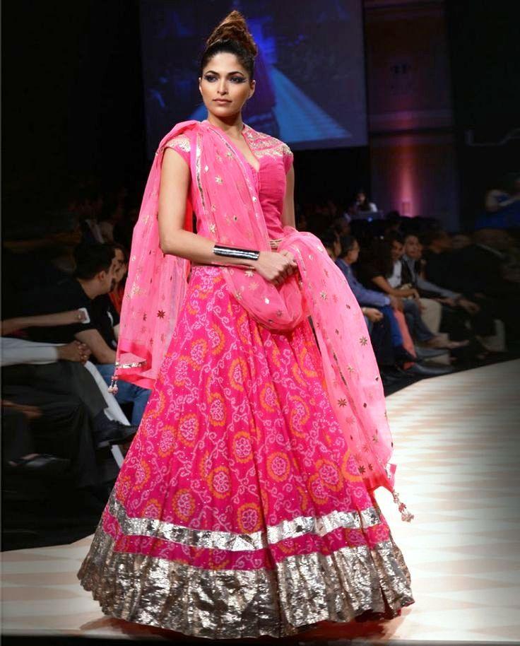 rajasthani pink bandhani lehenga by anita dongre with silver gota work