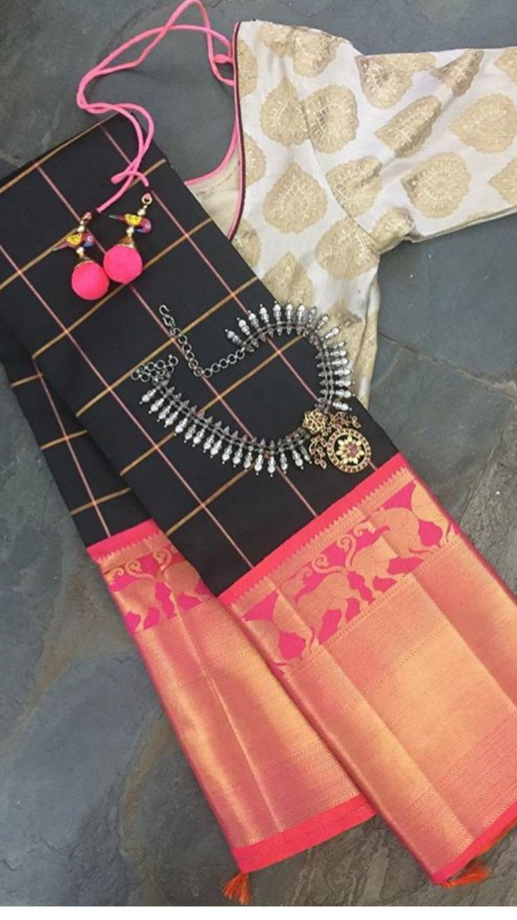 Black Kanchipuram Saree paired with white embroidered blouse