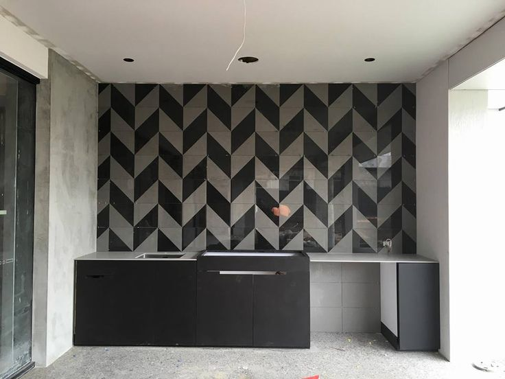 The tiles have been hand cut on a diagonal and placed together to create this dynamic