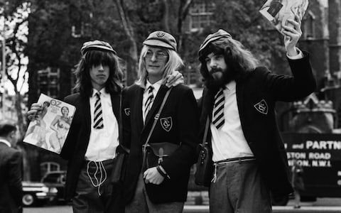 (From left) Richard Neville, James Anderson and Felix Dennis dressed in school uniforms, hold aloft copies of the magazine Oz, London, 1970